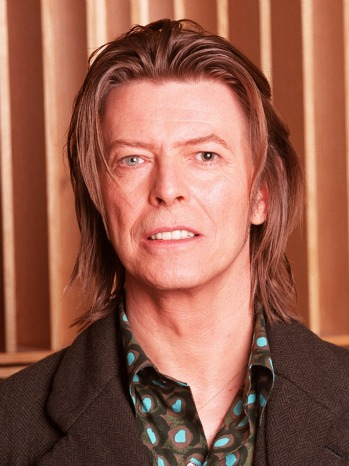 LONDON - : (UK NEWSPAPERS OUT WITHOUT PRIOR CONSENT FROM DAVE HOGAN. PLEASE CONTACT SALES TEAM WITH ENQUIRIES) Musician David Bowie appears during a live radio interview with Radio One DJ's Mark and Lard at the Radio One Maida Vale studio in 2001 in London. (Photo by Dave Hogan/Getty Images) *** Local Caption *** David Bowie